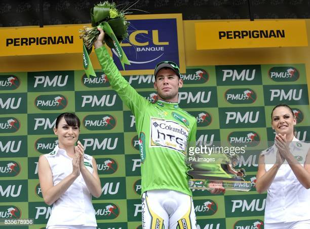 Team Columbia's Mark Cavendish wearing the green jersey on the podium after the fifth stage of the Tour de France between Le Cap d'Agde and Perpignan