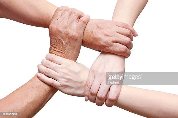 Team concept using joined hands isolated on white (Clipping Path!)