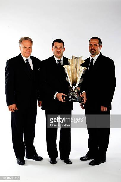 Team coowner Gene Haas driver/coowner Tony Stewart and crew chief Darian Grubb pose during the NASCAR Sprint Cup Series Champion's Week Awards...