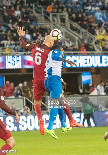 S Team defender John Brooks and Honduras forward Anthony Lozano vie for a pass during the FIFA World Cup Qualifier between the US Men's National team...