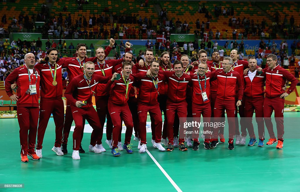 Team Denmark pose during the medal ceremony for Men's Handball after winning the gold medal on Day 16 of the Rio 2016 Olympic Games at Future Arena...