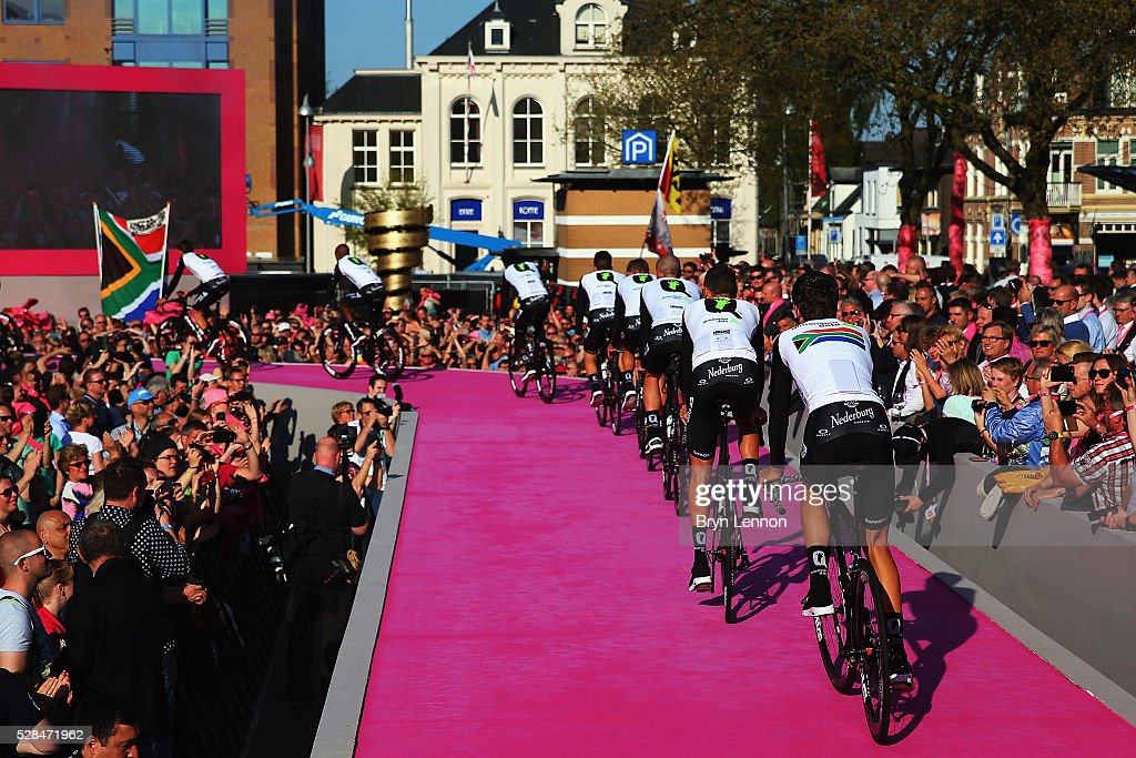 Team Dimension Data ride onto the stage during the Opening Ceremony and official Team Presentation for the 2016 Giro d'Italia at the City Hall on May 05, 2016 in Apeldoorn, Netherlands.