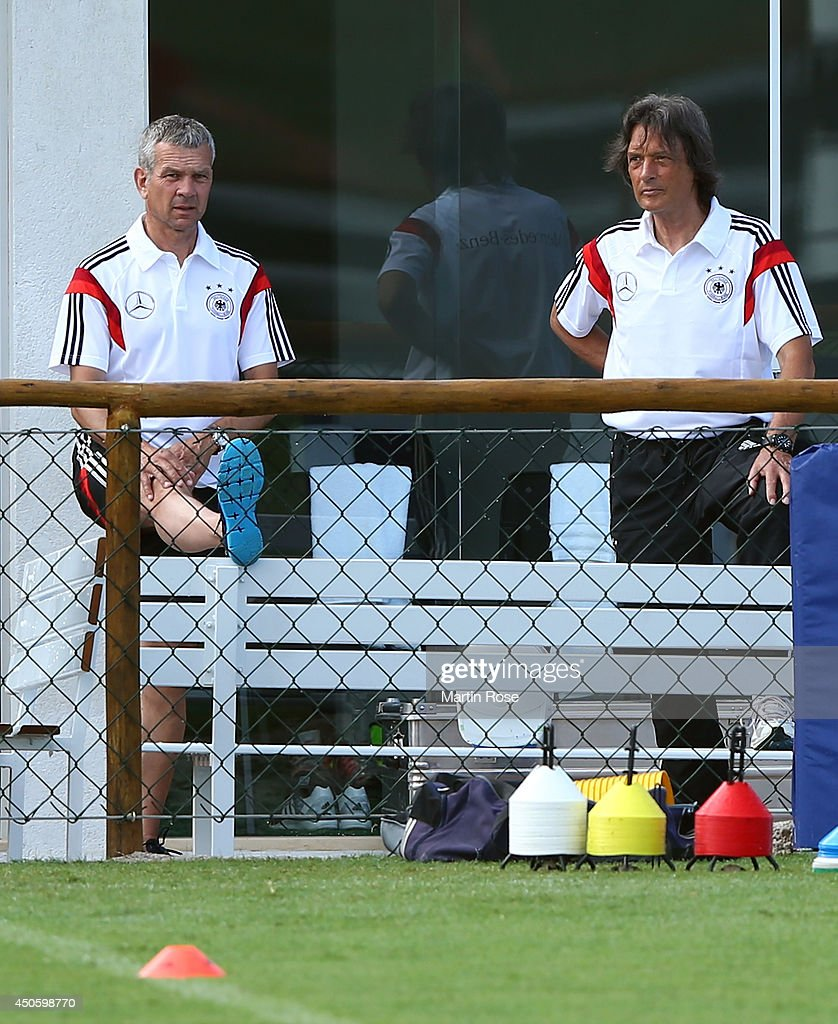 Team doctor Han Wilhelm Mueller Wohlfahrt (R) looks on during the German National team training at Campo Bahia on June 14, 2014 in Santo Andre, Brazil.