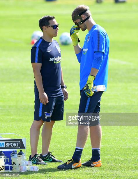 team doctor Hjun Park speaks with Thomas Kraft of Hertha BSC during the training camp on august 2 2017 in Schladming Austria