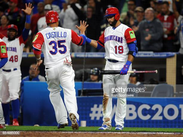 Team Dominican Republic catcher Wellington Castillo is greeted by right fielder Jose Bautista after Castillo scored on a hit in the seventh inning of...