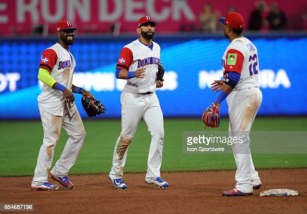 Team Dominican Republic right fielder Jose Bautista and shortstop Jose Reyes head off the field towards second baseman Robinson Cano after the...