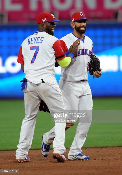 Team Dominican Republic right fielder Jose Bautista is greeted by shortstop Jose Reyes as they head off the field after the Dominican Republic...