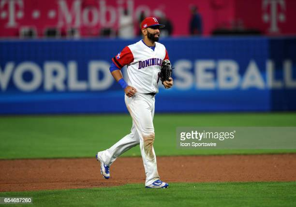 Team Dominican Republic right fielder Jose Bautista runs off the field after the Dominican Republic defeated team Venezuela 3 to 0 on March 16 during...