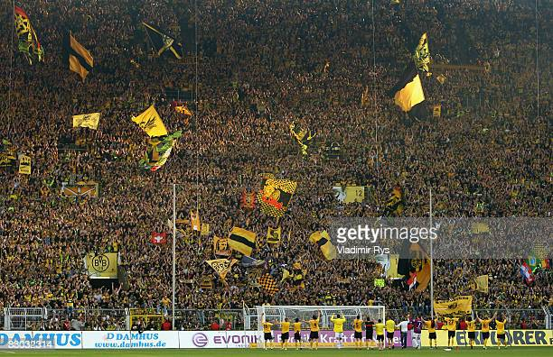 Team Dortmund acknowledge it's fans after winning 30 the Bundesliga match between Borussia Dortmund and VfB Stuttgart at the Signal Iduna Park on...