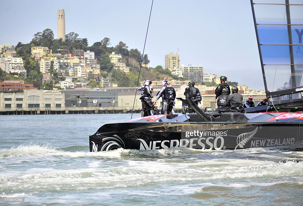 Team Emirates sails their AC-72 Racing Yacht near Coit Tower during a training session for the America's Cup competition in San Francisco on July 2, 2013. Opening ceremonies begin on July 4. AFP PHOTO/Josh Edelson