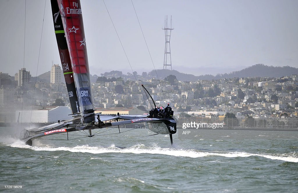 Team Emirates sails their AC-72 Racing Yacht near The Golden Gate Bridge during a training session for the America's Cup competition in San Francisco on July 2, 2013. Opening ceremonies begin on July 4. AFP PHOTO/Josh Edelson