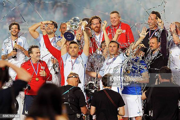 Team England celebrates after winning Soccer Aid at Old Trafford on June 5 2016 in Manchester England
