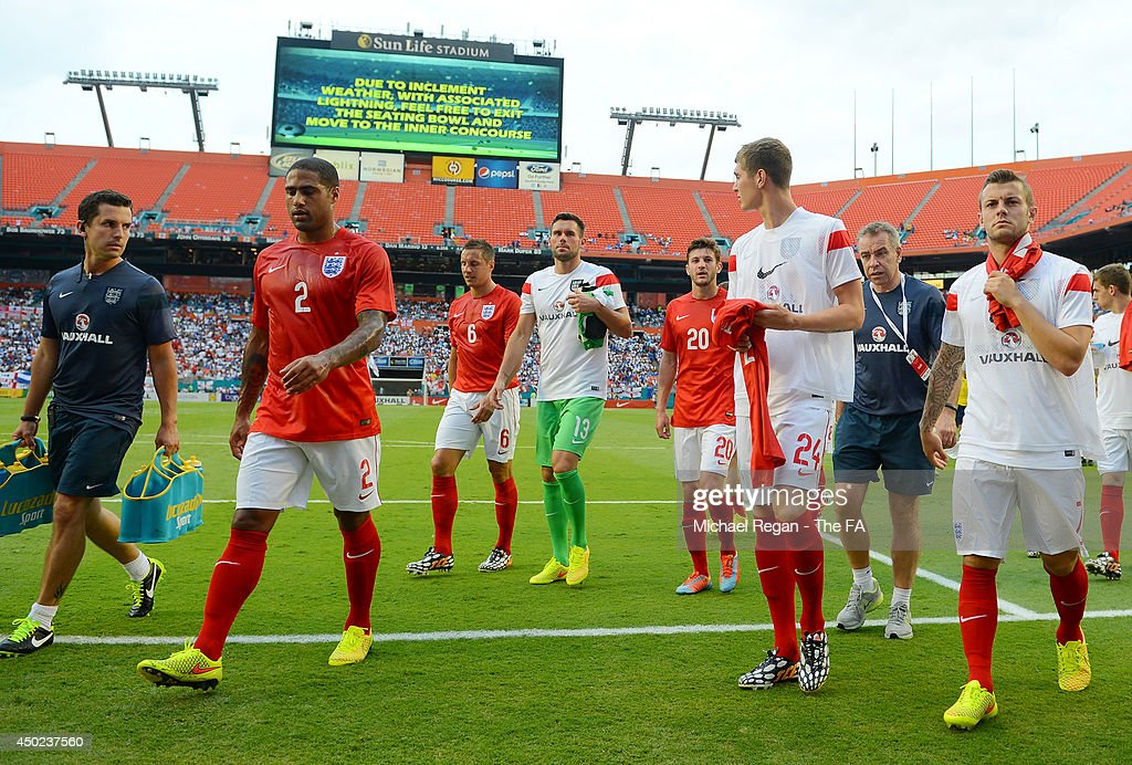 Team England walk off the field after the game being delayed due to inclement weather during the International Friendly match between England and Honduras at Sun Life Stadium on June 7, 2014 in Miami Gardens, Florida.
