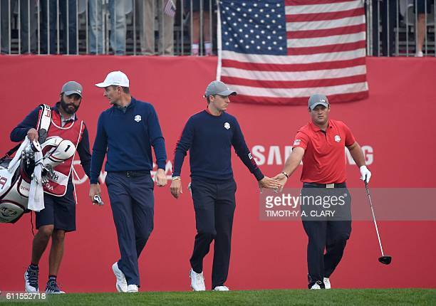 Team Europe Justin Rose Team USA Jordan Spieth and Patrick Reed walk during the Morning Foursome matches at the 41st Ryder Cup at Hazeltine National...