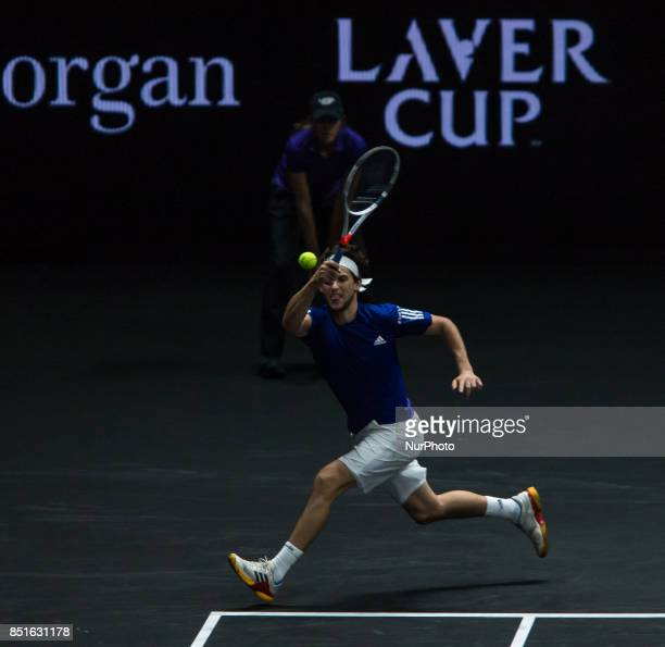 Team Europe player Dominic Thiem of Austria returns the ball to Team World player John Isner of United States during the first day at Laver Cup on...