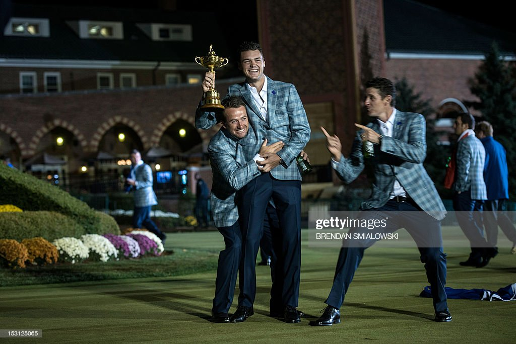 Team Europe's Graeme McDowell (L) of Northern Ireland, Martin Kaymer (C) of Germany and Justin Rose of England pose with the Ryder Cup after the final day of the 39th Ryder Cup at the Medinah Country Club September 30, 2012 in Medinah, Illinois. Europe produced the greatest comeback in Ryder Cup history to reel in the United States and retain the trophy. AFP PHOTO/Brendan SMIALOWSKI