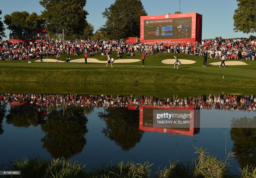 TOPSHOT - Team Europe's Thomas Pieters and Rory McIlroy and Team USA Dustin Johnson and Matt Kuchar walk up to the 16th green in their Friday Afternoon Four-ball match during the 41st Ryder Cup at Hazeltine National Golf Course in Chaska, Minnesota, September 30, 2016 / AFP / TIMOTHY