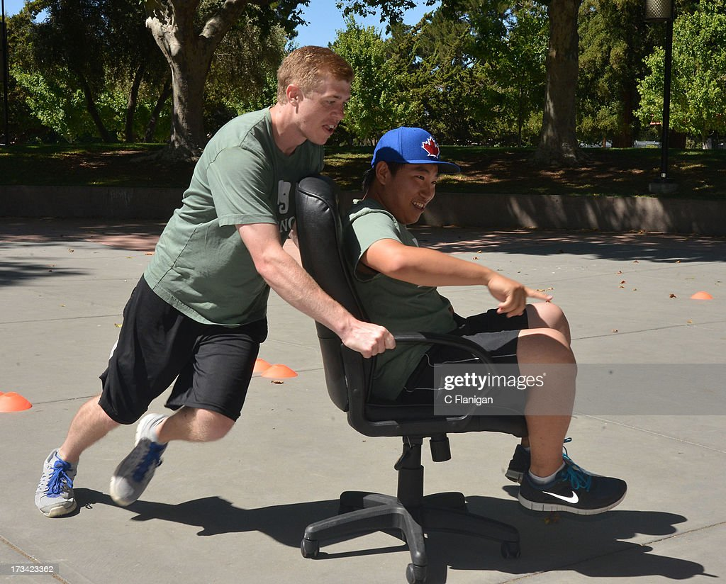 Team Evernote participates in the Business Chair racing game during the Founder Institute's Silicon Valley Sports League event on July 13, 2013 in Palo Alto, California.