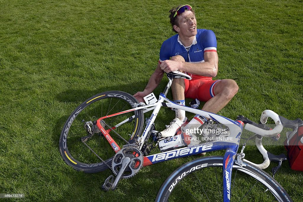 Team FDJ French cyclist Arnaud Demare reacts after flattening a tyre during the 113th edition of the Paris-Roubaix Paris-Roubaix one-day classic cycling race in Roubaix on April 12, 2015.
