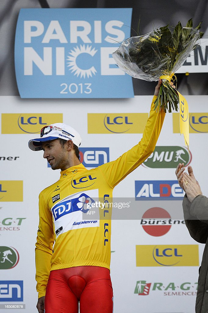 Team FDJ French cyclist Nacer Bouhanni celebrates with his overall leader yellow jersey on the podium of the first stage of the 71st Paris-Nice cycling race between Saint Germain en Laye and Nemours, on March 4, 2013.