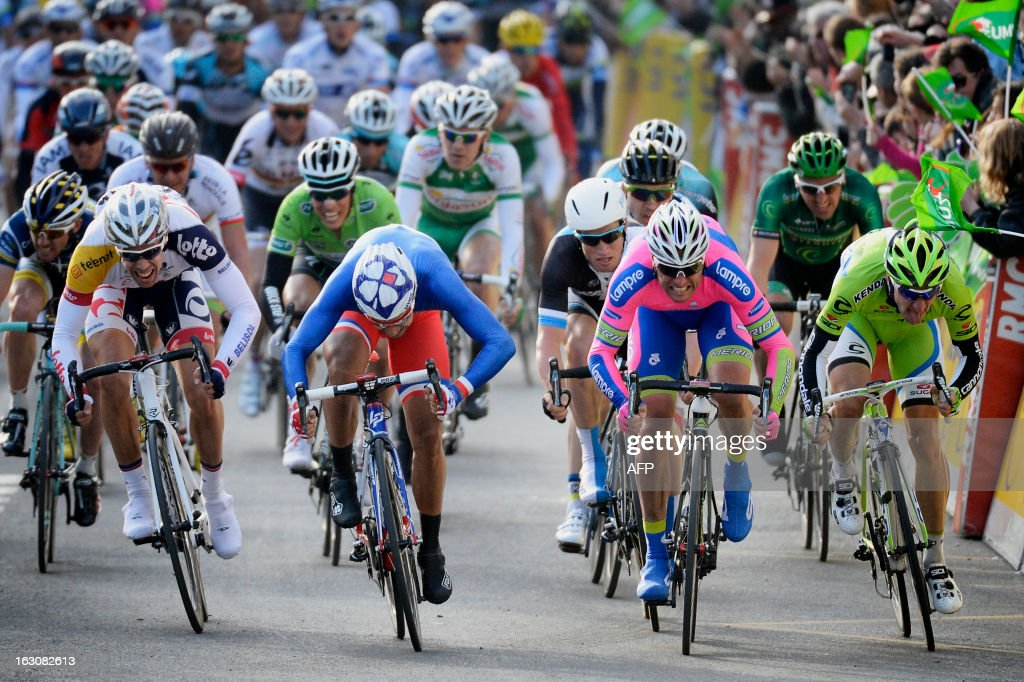 Team FDJ French cyclist Nacer Bouhanni (2nd L) sprints to win the first stage of the 71st Paris-Nice cycling race between Saint Germain en Laye and Nemours, on March 4, 2013.