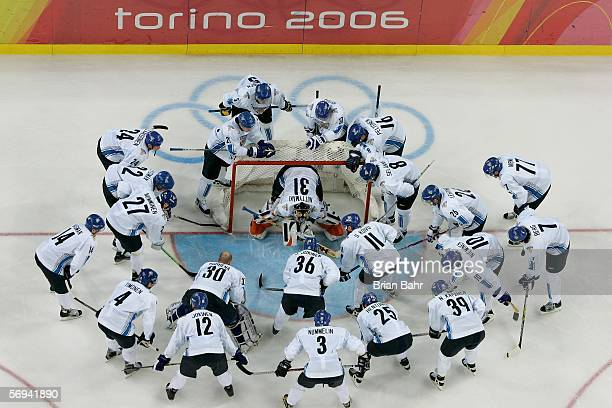 Team Finland huddles around the net before the final of the men's ice hockey match between Finland and Sweden during Day 16 of the Turin 2006 Winter...