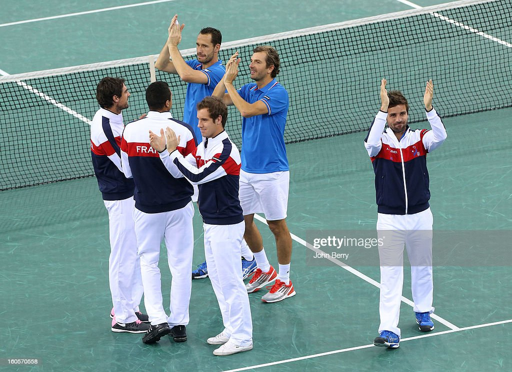 Jeremy Chardy, <a gi-track='captionPersonalityLinkClicked' href=/galleries/search?phrase=Jo-Wilfried+Tsonga&family=editorial&specificpeople=553803 ng-click='$event.stopPropagation()'>Jo-Wilfried Tsonga</a>, Michael Llodra, <a gi-track='captionPersonalityLinkClicked' href=/galleries/search?phrase=Richard+Gasquet&family=editorial&specificpeople=206501 ng-click='$event.stopPropagation()'>Richard Gasquet</a>, Julien Bennetteau and Arnaud Clement, coach of France thank the public after their overall victory over Israel on day two of the Davis Cup first round match between France and Israel at the Kindarena stadium on February 2, 2013 in Rouen, France.