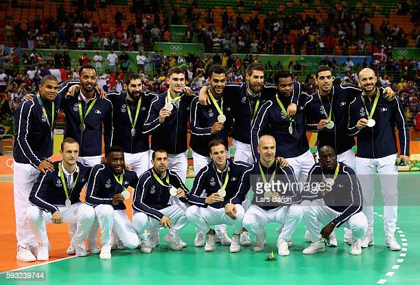 Team France pose during the medal ceremony for Men's Handball after winning the silver medal on Day 16 of the Rio 2016 Olympic Games at Future Arena...