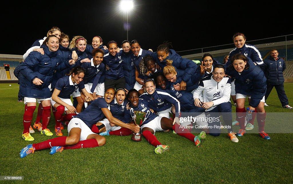 Team France poses with the Cyprus Cup after the final between England and France at GSP stadium on March 12, 2014 in Nicosia, Cyprus.