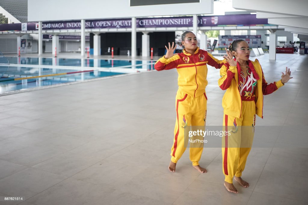 A team from Makassar practice the movement before start artistic swim contest in Indonesia Open Aquatic Championship (IOAC) at the renovated Aquatics Stadium in Gelora Bung Karno sporting complex, Senayan in Jakarta, Indonesia on December 7, 2017. IOAC held from 5 to 15 December 2017 by the Board of Indonesia's Pool Association (PBRSI) as part of test event before Asian Games 2018 venue.
