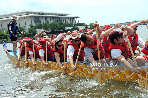 A team from of Cornell University alumni shove off into the Potomac River to race into the DC Dragon Boat Festival June 1 2008