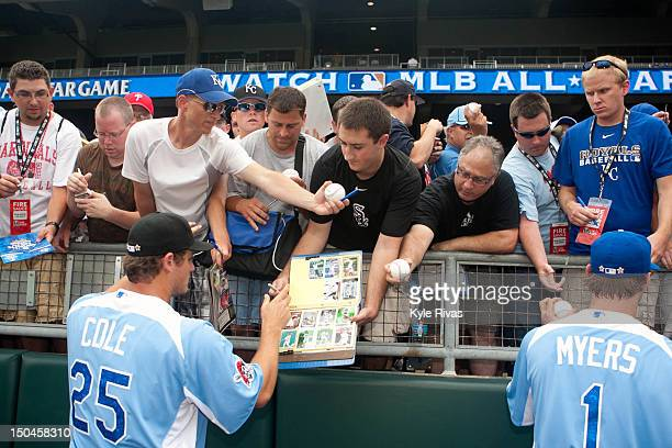 S Team Futures AllStar Gerrit Cole of the Pittsburgh Pirates signs autographs for fans before the 2012 SiriusXM AllStar Futures Game against the...