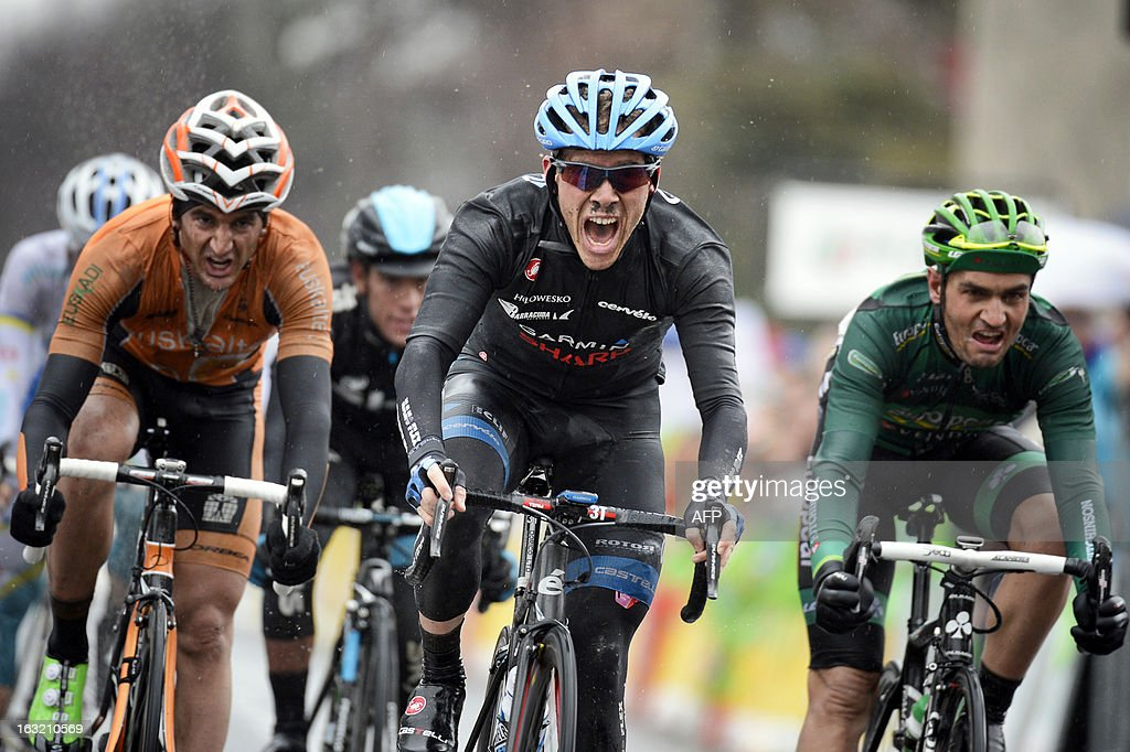 Team Garmin-Sharp's US cyclist Andrew Talansky (C) celebrates as he wins the third stage of the 71st Paris-Nice cycling race between Chatel-Guyon and Brioude, on March 6, 2013.
