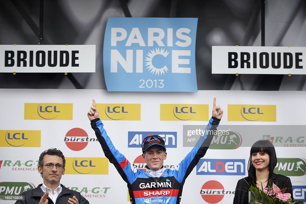 Team Garmin-Sharp's US cyclist Andrew Talansky celebrates on the podium after winning the third stage of the 71st Paris-Nice cycling race between Chatel-Guyon and Brioude, on March 6, 2013.