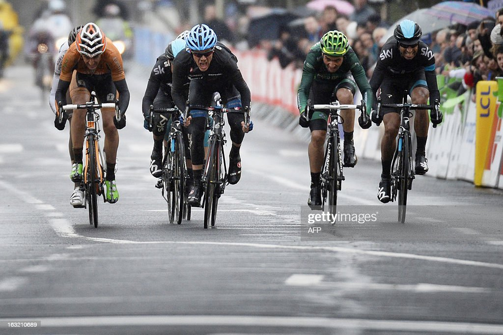 Team Garmin-Sharp's US cyclist Andrew Talansky (C) sprints to win the third stage of the 71st Paris-Nice cycling race between Chatel-Guyon and Brioude, on March 6, 2013.