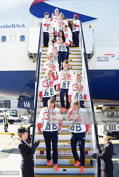 Team GB athletes and members of the women's gold medal winning hockey team leave the aeroplane after arriving home at Heathrow Airport on August 23...