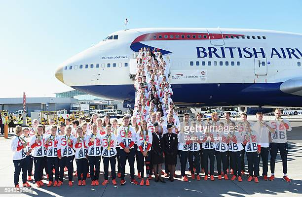 Team GB athletes pose after arriving home at Heathrow Airport on August 23 2016 in London England The 2016 British Olympic Team arrived back to...