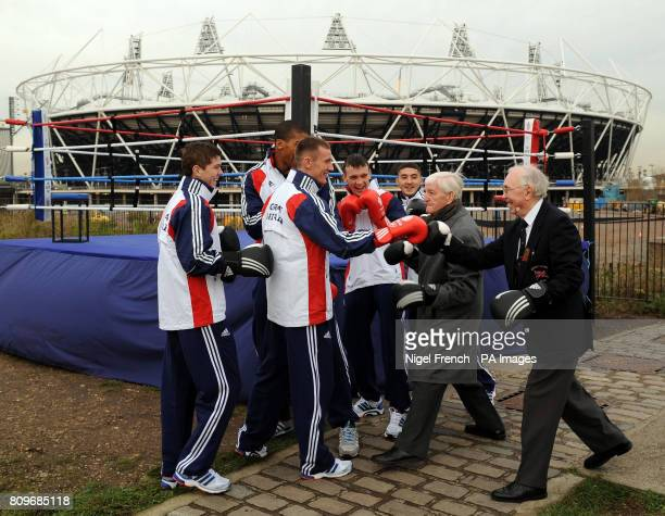 Team GB boxers Luke Campbell Anthony Joshua Tom Stalker Fred Evans and Andrew Selby are joined by 1948 boxing Olympians Tommy Proffitt and Ron Cooper...