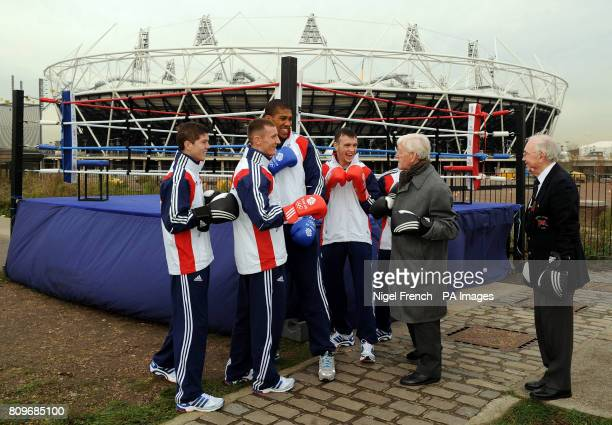 Team GB boxers Luke Campbell Tom Stalker Anthony Joshua Fred Evans and Andrew Selby are joined by 1948 boxing Olympians Tommy Proffitt and Ron Cooper...