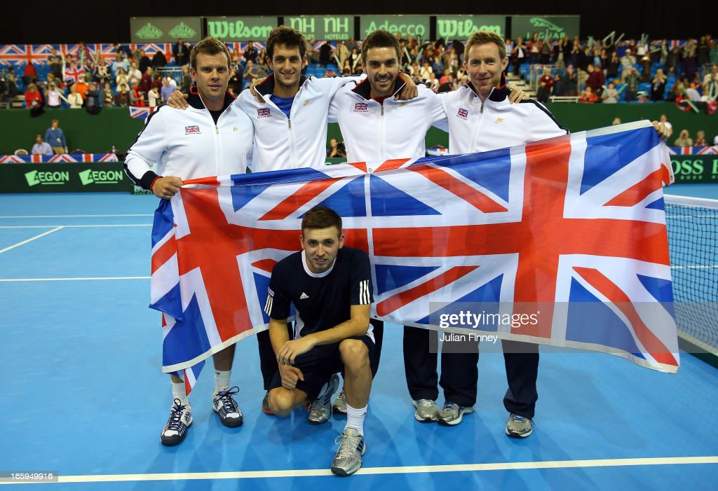 Team GB (L-R)Captain Leon Smith, James Ward, Colin Fleming, Jonathan Marray and Dan Evans of Great Britain (front) celebrate defeating Russia during day three of the Davis Cup match between Great Britain and Russia at the Ricoh Arena on April 7, 2013 in Coventry, England.