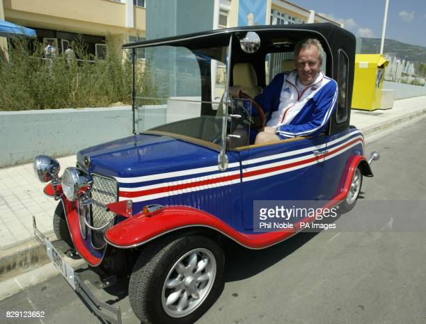 Team GB Chef de Mission Simon Clegg sits in a car painted in the colours of the British flag near the team's headquarters in the Olympic Village in...