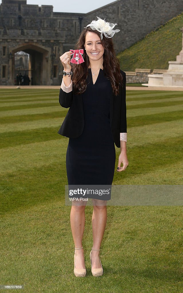 Team GB cyclist Danielle King poses with her MBE after an Investiture ceremony at Windsor Castle on April 10, 2013 in Windsor, England.