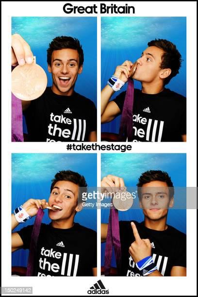 Team GB diver Tom Daley poses for pictures with his Bronze Medal in the adidas photobooth on August 12 at the adidas Media Lounge in Stratford City...