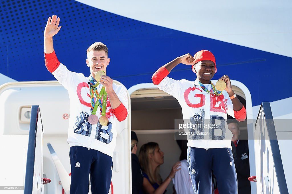 Team GB Gymnast and gold medallist Max Whitlock poses with fellow gold medallist and boxer Nicola Adams after arriving home at Heathrow Airport on...