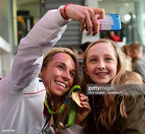 Team GB Hockey gold medalist Susannah Townsend left poses for a selfie with a fan during the Maxifuel Super Sixes autograph session at Wembley Arena...
