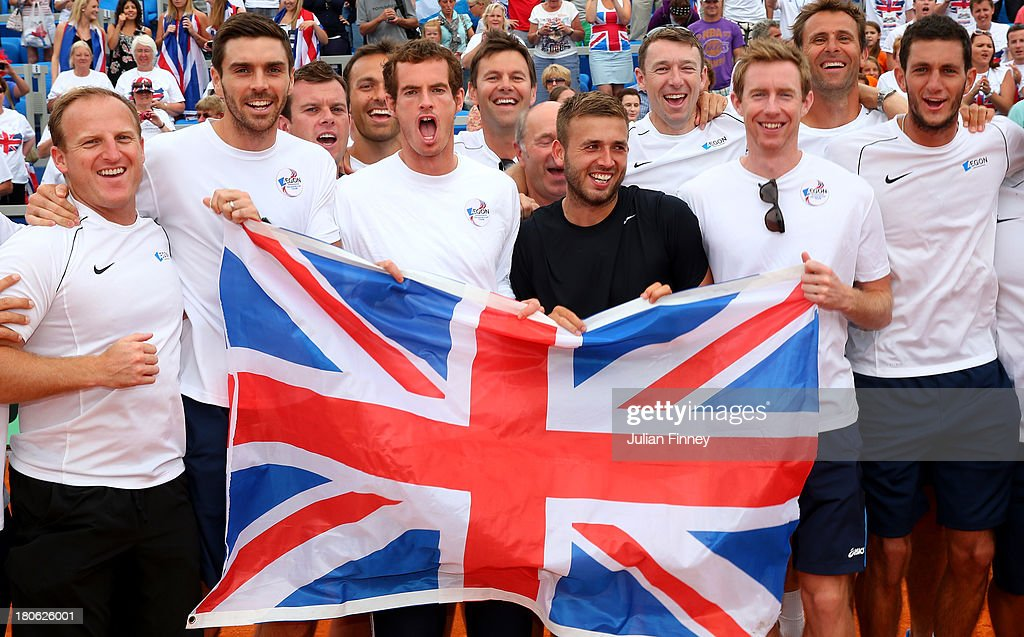 Team GB (L-R) Matt Little, Colin Fleming, <a gi-track='captionPersonalityLinkClicked' href=/galleries/search?phrase=Leon+Smith+-+Tennis+Coach&family=editorial&specificpeople=12698515 ng-click='$event.stopPropagation()'>Leon Smith</a>, <a gi-track='captionPersonalityLinkClicked' href=/galleries/search?phrase=Ross+Hutchins&family=editorial&specificpeople=2365752 ng-click='$event.stopPropagation()'>Ross Hutchins</a>, Andy Murray Daniel Evans, Jonny Marray, Colin Beecher and James Ward celebrate during day three of the Davis Cup World Group play-off tie between Croatia and Great Britain at Stadion Stella Maris on September 15, 2013 in Umag, Croatia.