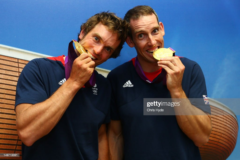 Team GB Men's Canoe Double C2 Gold medalists Tim Baillie and <a gi-track='captionPersonalityLinkClicked' href=/galleries/search?phrase=Etienne+Stott&family=editorial&specificpeople=4145666 ng-click='$event.stopPropagation()'>Etienne Stott</a> pose with their Gold medal at Team GB House in Stratford on August 2, 2012 in London, England.