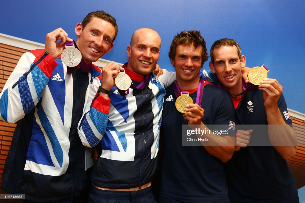 Team GB Men's Canoe Double C2 Silver medalists <a gi-track='captionPersonalityLinkClicked' href=/galleries/search?phrase=Richard+Hounslow&family=editorial&specificpeople=4145841 ng-click='$event.stopPropagation()'>Richard Hounslow</a> and <a gi-track='captionPersonalityLinkClicked' href=/galleries/search?phrase=David+Florence&family=editorial&specificpeople=4145655 ng-click='$event.stopPropagation()'>David Florence</a> and Canoe Double C2 Gold medalists Tim Baillie and <a gi-track='captionPersonalityLinkClicked' href=/galleries/search?phrase=Etienne+Stott&family=editorial&specificpeople=4145666 ng-click='$event.stopPropagation()'>Etienne Stott</a> pose with their Gold medal at Team GB House in Stratford on August 2, 2012 in London, England.