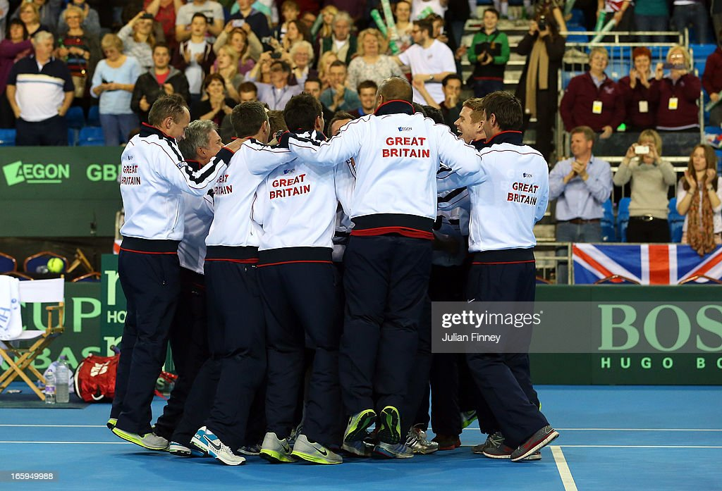 Team GB players and staff celebrate defeating Russia during day three of the Davis Cup match between Great Britain and Russia at the Ricoh Arena on April 7, 2013 in Coventry, England.