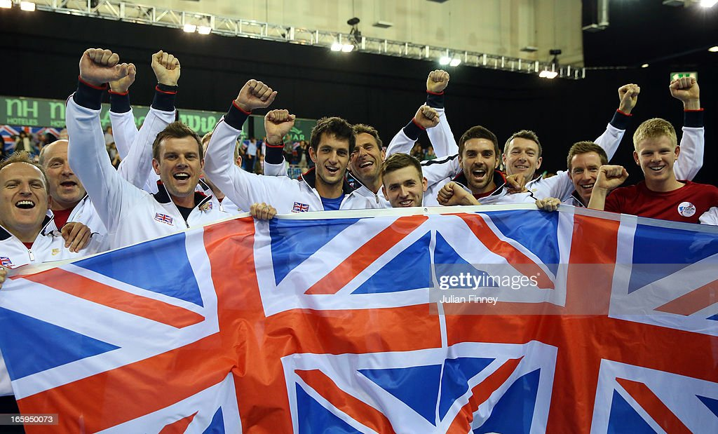 Team GB players James Ward, Colin Fleming, <a gi-track='captionPersonalityLinkClicked' href=/galleries/search?phrase=Jonathan+Marray&family=editorial&specificpeople=210685 ng-click='$event.stopPropagation()'>Jonathan Marray</a>, Dan Evans of Great Britain and Captain <a gi-track='captionPersonalityLinkClicked' href=/galleries/search?phrase=Leon+Smith+-+Tennis+Coach&family=editorial&specificpeople=12698515 ng-click='$event.stopPropagation()'>Leon Smith</a> celebrate defeating Russia during day three of the Davis Cup match between Great Britain and Russia at the Ricoh Arena on April 7, 2013 in Coventry, England.